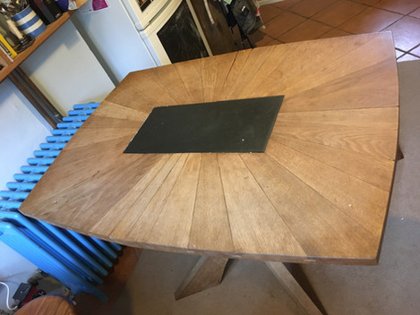 I made this table top from a great big pile of oak offcuts which had accumulated after glazing several oak frames.  It was almost firewood, but with a bit of work it looks great, and the slab of slate in the centre is perfect for a hot dish.