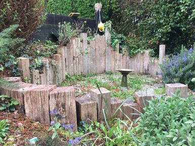 So this isnt really carpentry, more an arrangement of leftovers.  It is still very cool though and I love it even more as the garden begins to swallow it back up.