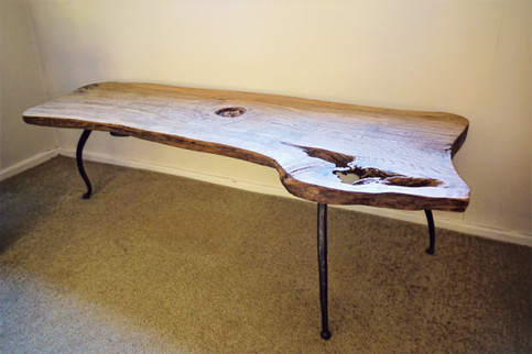 A little coffee table made from a throughsawn slab which had some rot in it, and iron legs which i made on my forge