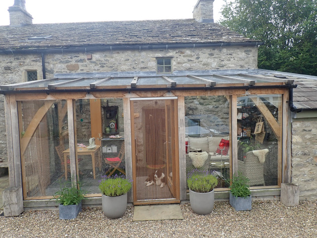 The Sitooterie (a place to sit oot in) is a garden room extension that I built for my parent's home.  The silvering nature of the oak compliments their Grade 2 listed stone cottage in the Yorkshire Dales National Park.