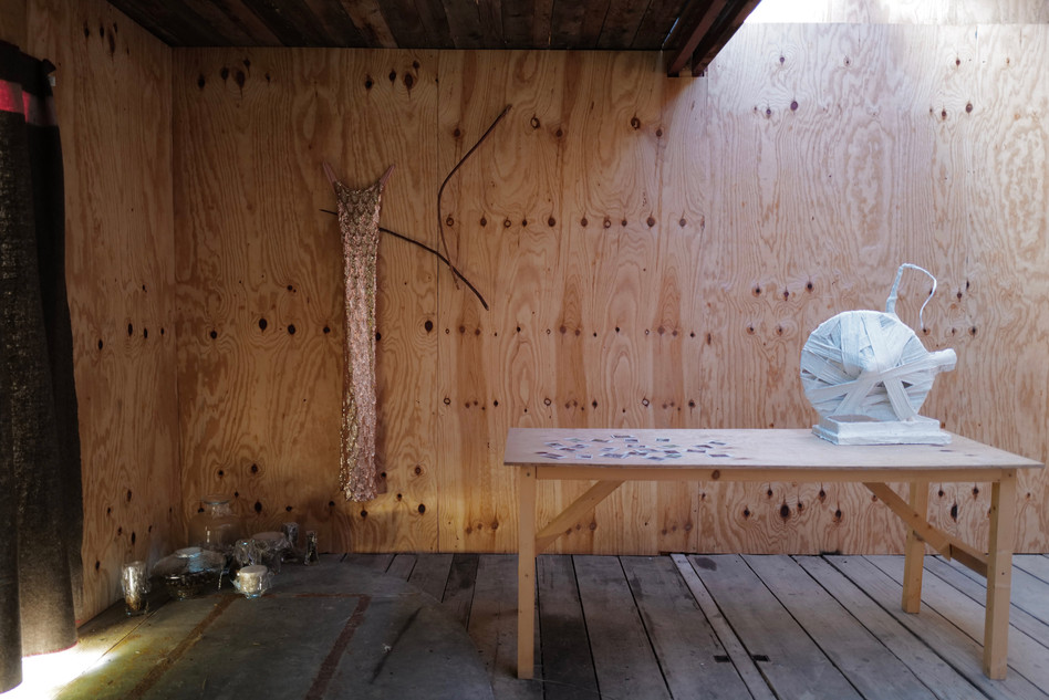 On the table: Moon Car, Plaster, Metal, Wood, ca. 30 x 40 x 60 cm, 2020. Wall: Dress, Bow and Arrow; on the floor: mushrooms.