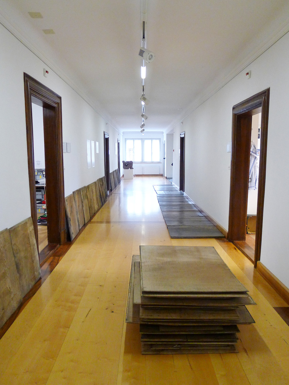 in front: Stapel (stack), 45 x 120 cm, various old wooden panels; left: 13. Gemach (13th room), 67 x 1240 cm, 24 pieces of baroque wood. right: Holzweg (off the track), 84 x 800 cm, 30 pieces, historic wood, 2014