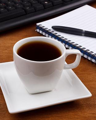 coffee-on-an-office-desk-P9U288L.jpg