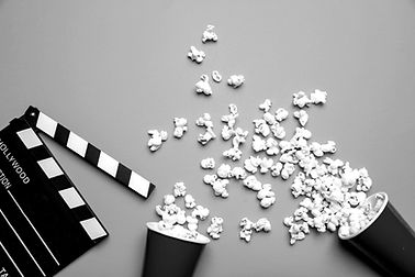 clapperboard-and-pop-corn-on-blue-color-