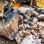close-up-of-excavator-bucket-loading-roc