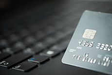 credit-card-on-laptop-PREJC57.JPG