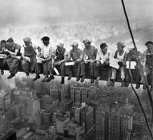 skyscaper workers sitting on beam