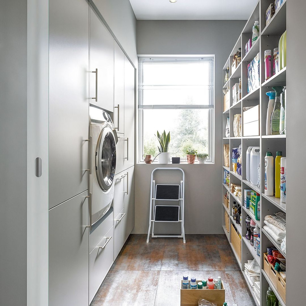 narrow utility room conversion in white with washing machine and shelf storage