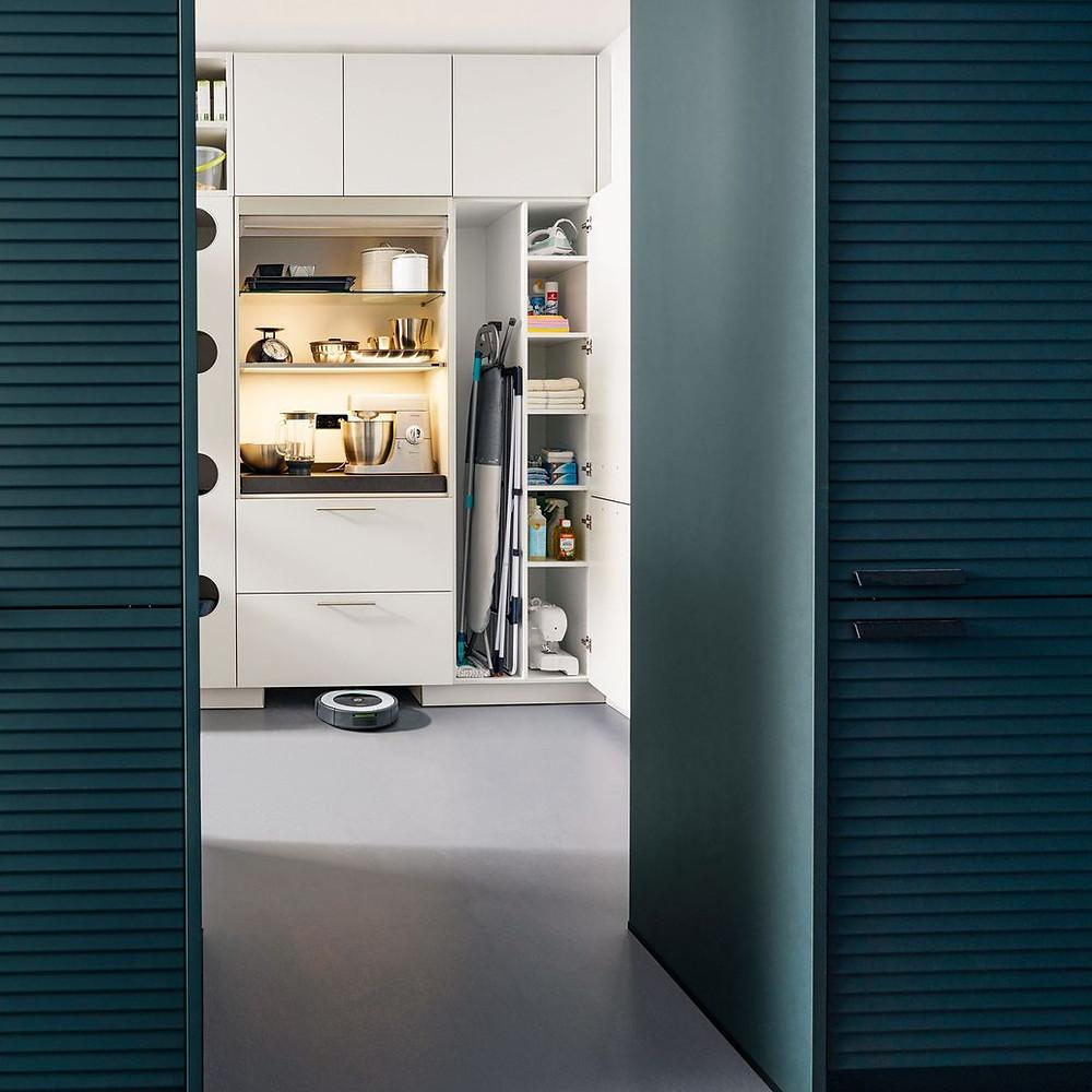 a modern utility room design docked onto a kitchen