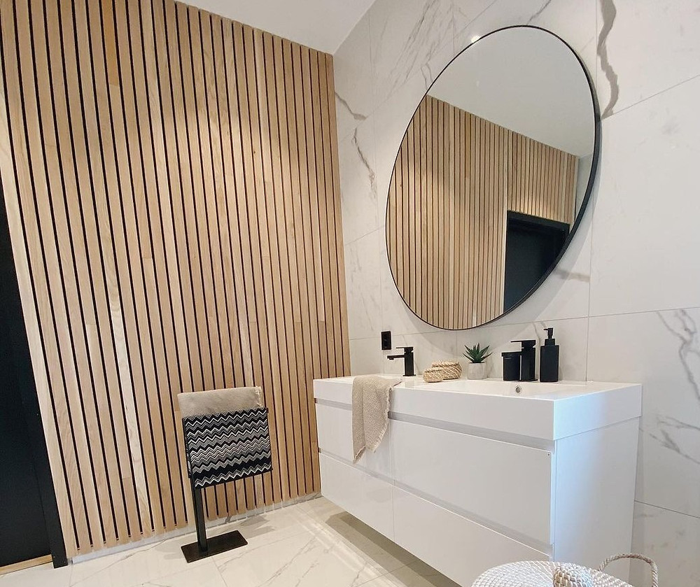 Wooden feature wall in white bathroom