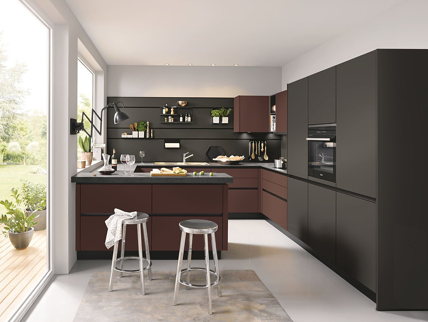 bespoke german kitchen in dark grey and maroon with stools