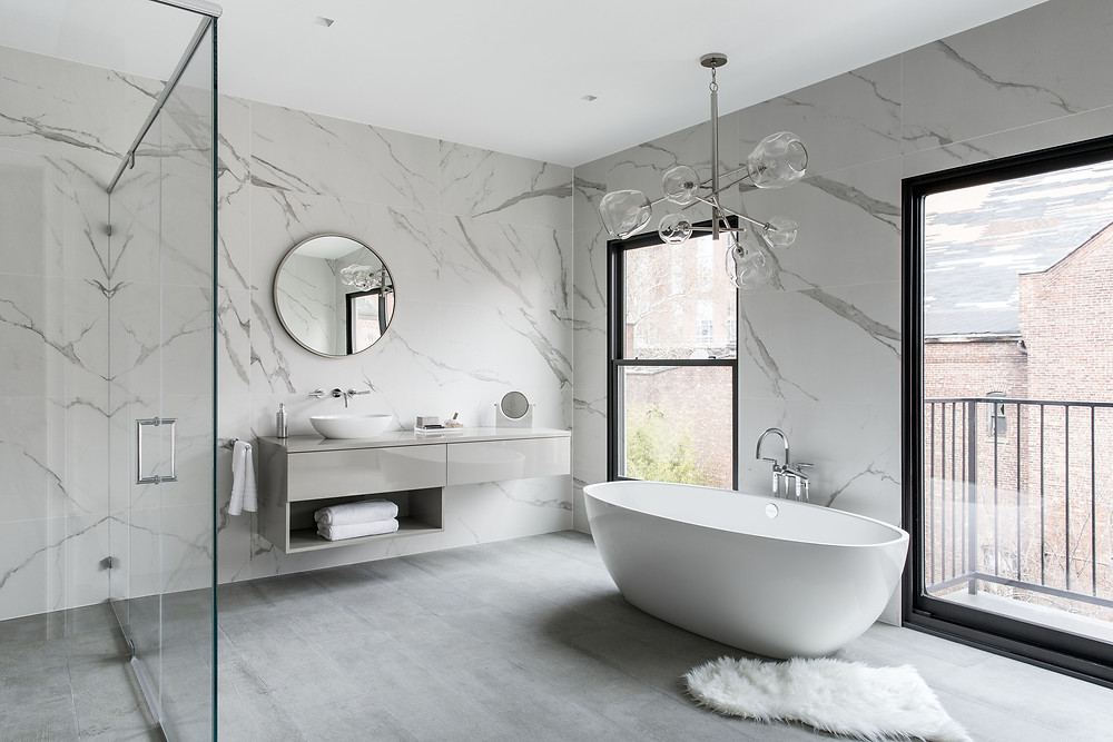 white modern bathroom design with marble wall