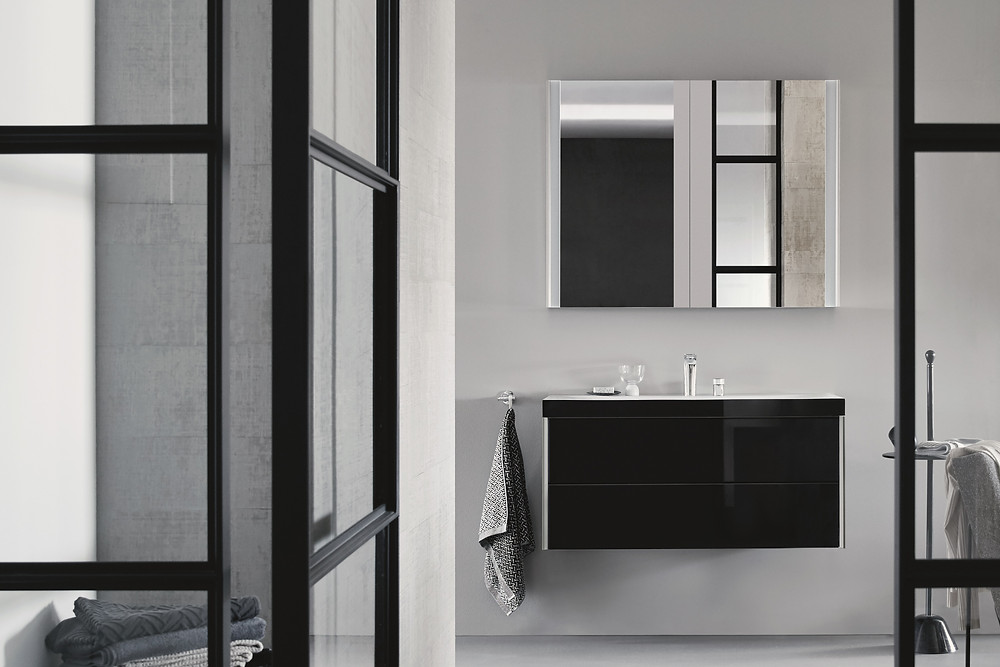 black and white modern bathroom design with glass panels and black vanity unit