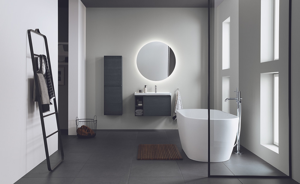 luxury modern black and white bathroom with smart mirror and ladder heater