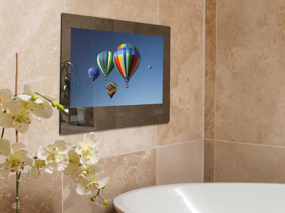 bathroom tv screen in modern, luxury bathroom