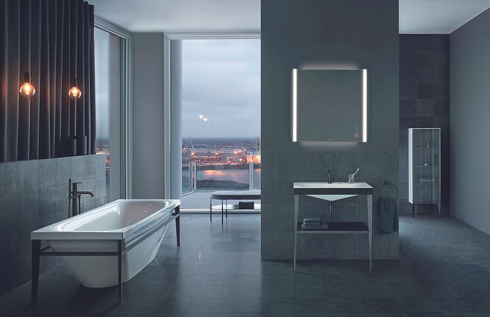 city bathroom design with illuminated mirror and bathtub