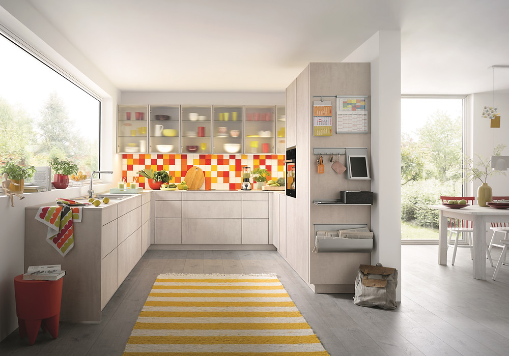 bright family kitchen idea with orange and red coloured tiles