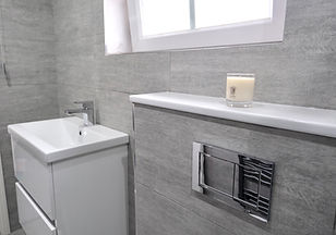 white sink and grey bathroom
