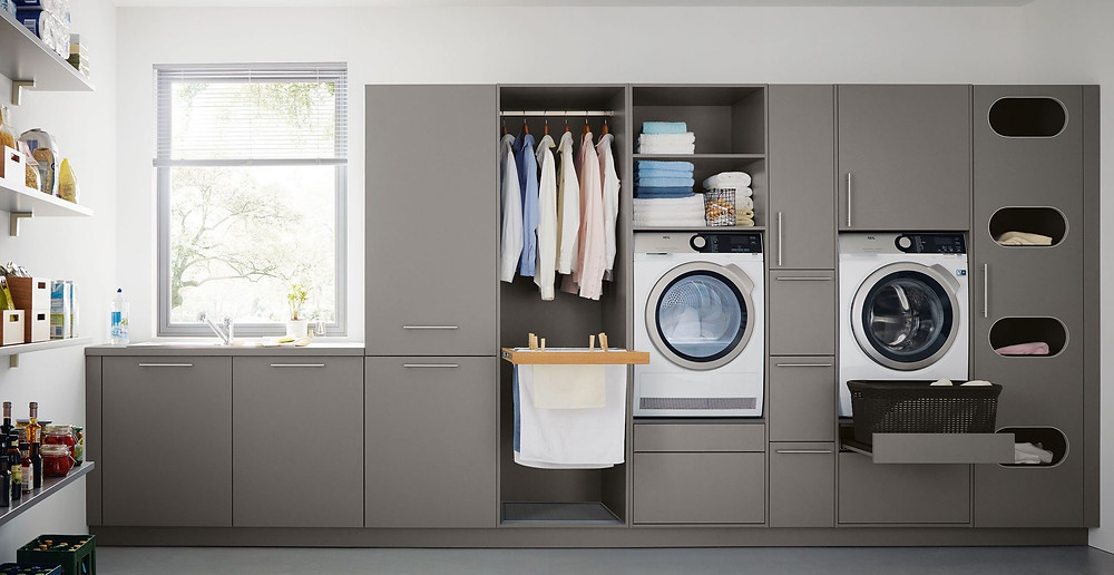 grey utility room attached to luxury kitchen design from German Schuller kitchens