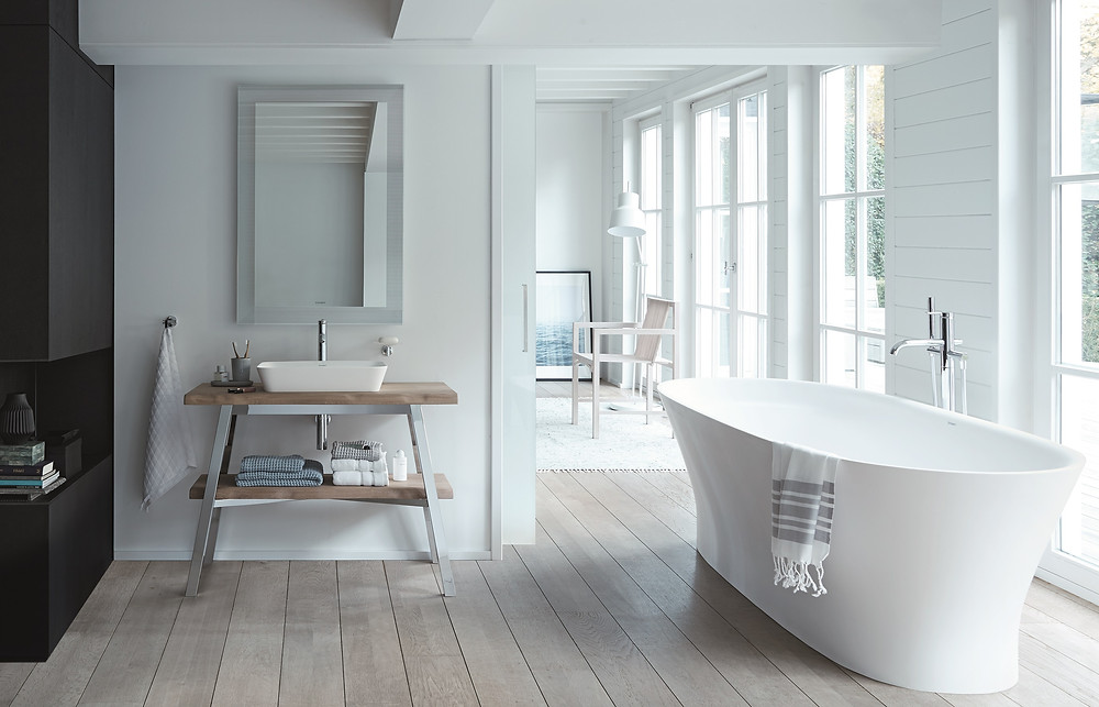 white bathroom design with stand alone bathtub and wooden vanity unit