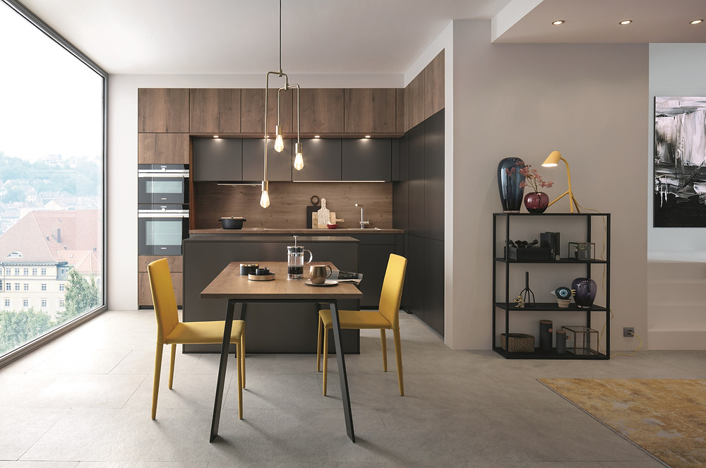 modern city kitchen design with wooden units and yellow chairs