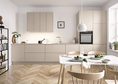german schuller kitchen design in beige and white with table and chairs