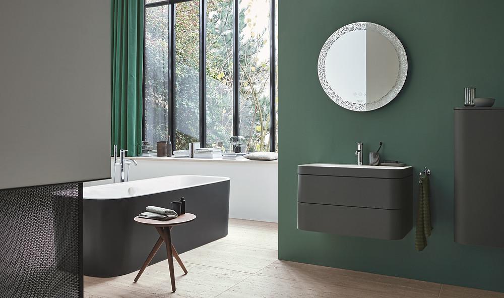modern green and black bathroom with floating vanity unit and black bathtub
