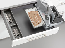 Integrated multi-purpose slicer for drawer