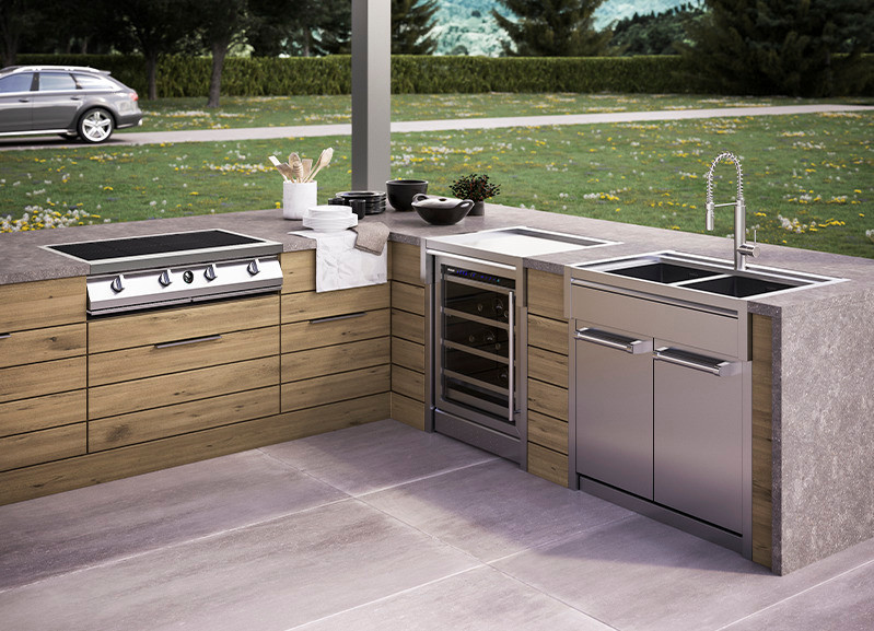 Steel Cucine outdoor kitchen design with barbecue and sink area