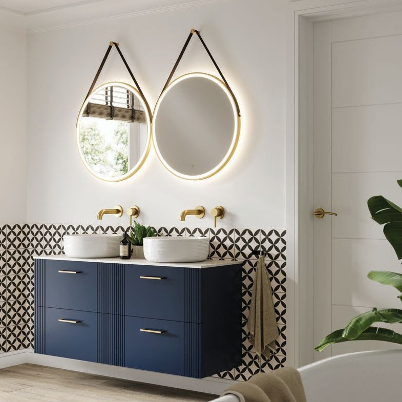 light up bathroom mirror with blue cabinet