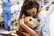 female-patient-hugging-a-therapy-dog-in-