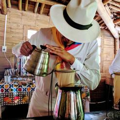 A colombian barista preparing a fresh cu