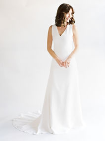 V-neck silk crepe modified A-line gown.