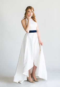 Silk mikado high-low ballgown with keyhole back and pockets. Detachable crushed velvet belt in white, blush, navy or black.