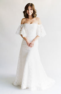 Strapless modified A-line lace gown. Lace trumpet sleeves can be worn 2 ways and are detachable.