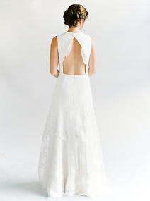 Sleeveless leaf embroidered Venise lace A-line gown with keyhole back.