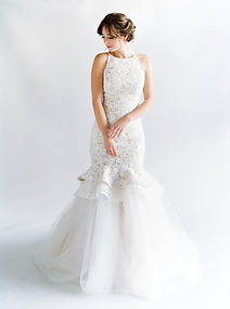 Mock halter fit-to-flare lace gown. Detachable tulle skirt.