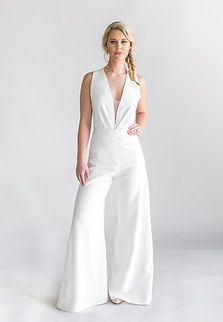 Silk crepe pleated deep v-neck blouse with silk satin ribbon straps twisted at the back (body suit).  Silk crepe wide-led palazzo trousers with satin ribbon tuxedo stripe.