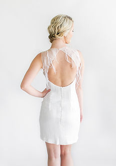 Matt sequin shift cocktail dress with open back and ostrich feather detail.