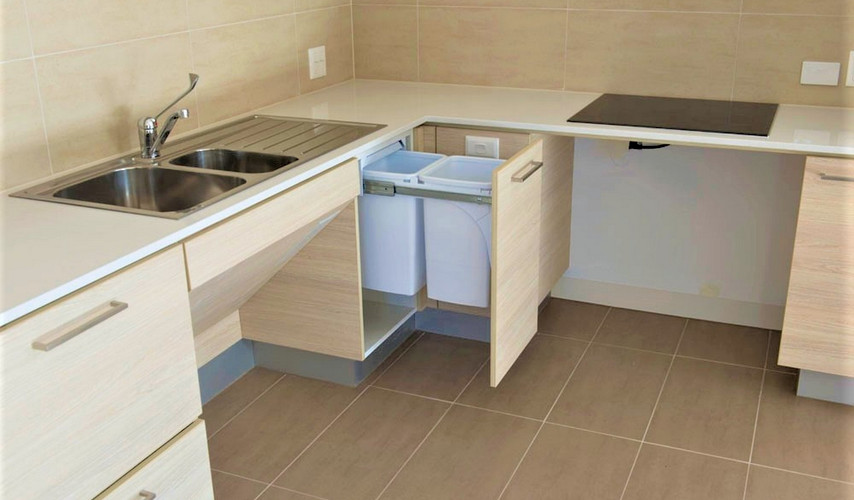 G02 kitchen with waste disposal feature.