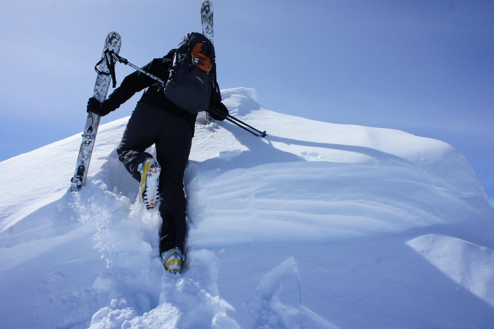 Kicking steps to the summit of Observation Sub Peak