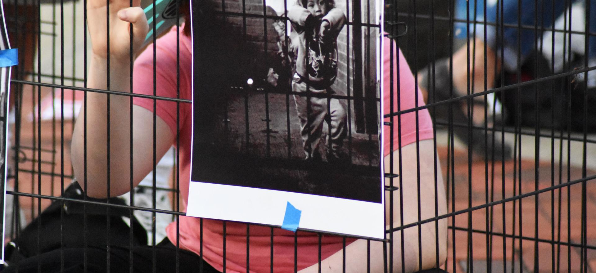 school children in cages.jpg