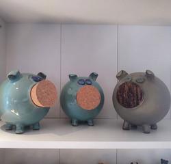 Three little piggy banks by Earth 'n Fir