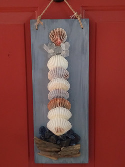 Shell lighthouse wall hanging