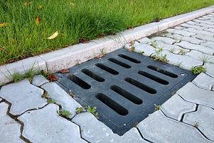 plastic-drain-gutter-green-grass-lawn-st