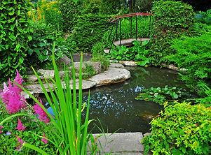 cozy-garden-with-decorative-lake-bridge-