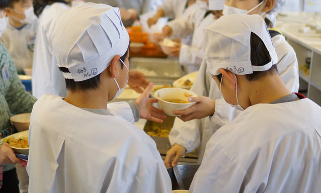 Students serving school lunch