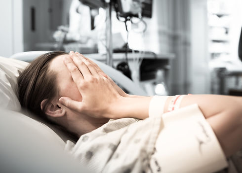 Young woman patient lying at hospital be