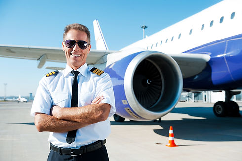 Confident pilot. Confident male pilot in