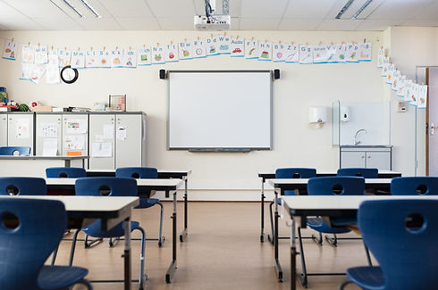 empty-classroom-with-whiteboard-P7JRC6B.